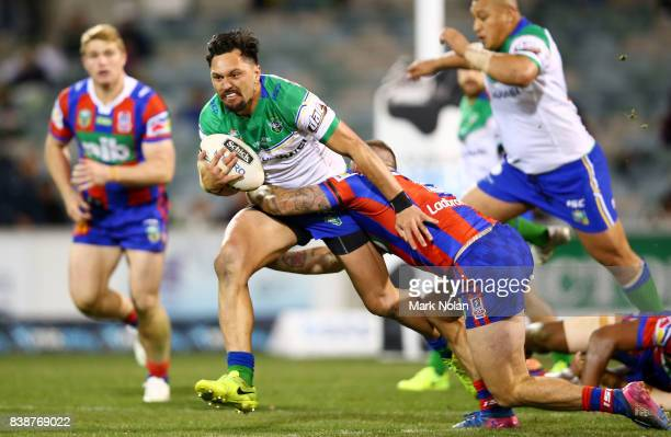 Jordan Rapana of the Raiders runs the ball during the round 25 NRL match between the Canberra Raiders and the Newcastle Knights at GIO Stadium on...