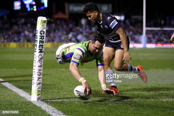 Jordan Rapana of the Raiders scores a try during the round 22 NRL match between the Cronulla Sharks and the Canberra Raiders at Southern Cross Group...