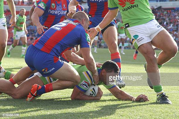 Jordan Rapana of the Raiders scores a try during the round three NRL match between the Newcastle Knights and the Canberra Raiders at Hunter Stadium...