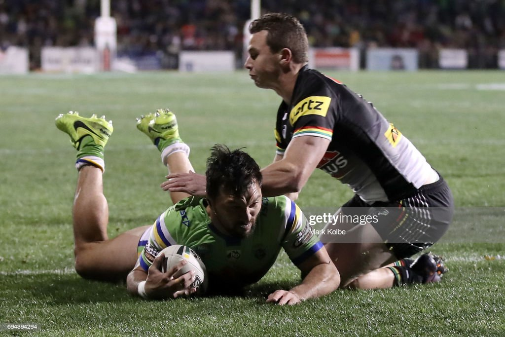 Jordan Rapana of the Raiders scores atry under pressure from Dylan Edwards of the Panthers during the round 14 NRL match between the Penrith Panthers and the Canberra Raiders at Carrington Park on June 10, 2017 in Bathurst, Australia.