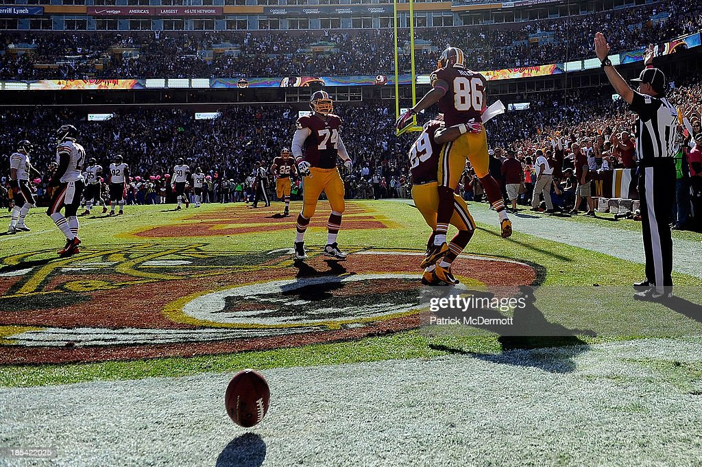 <a gi-track='captionPersonalityLinkClicked' href=/galleries/search?phrase=Jordan+Reed&family=editorial&specificpeople=6893664 ng-click='$event.stopPropagation()'>Jordan Reed</a> #86 of the Washington Redskins celebrates after scoring a touchdown in the second quarter during an NFL game against the Chicago Bears at FedExField on October 20, 2013 in Landover, Maryland.