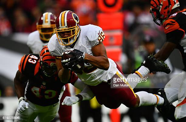 Jordan Reed of the Washington Redskins dives over to score a touchdown during the NFL International Series Game between Washington Redskins and...