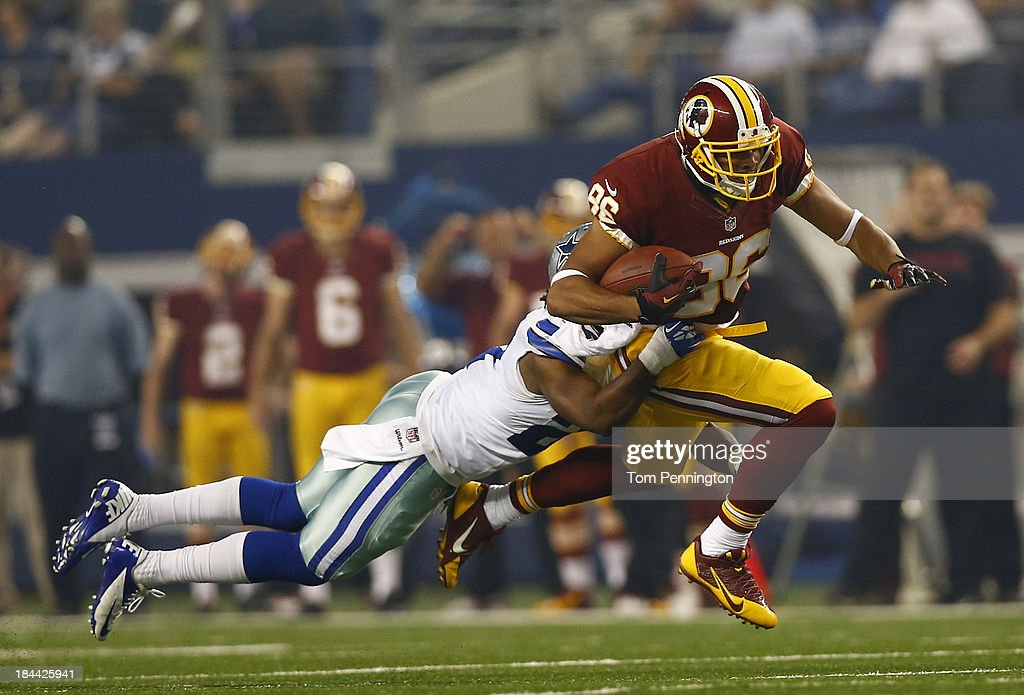 Jordan Reed of the Washington Redskins is hit by JJ Wilcox of the Dallas Cowboys during the first quarter at ATT Stadium on October 13 2013 in...