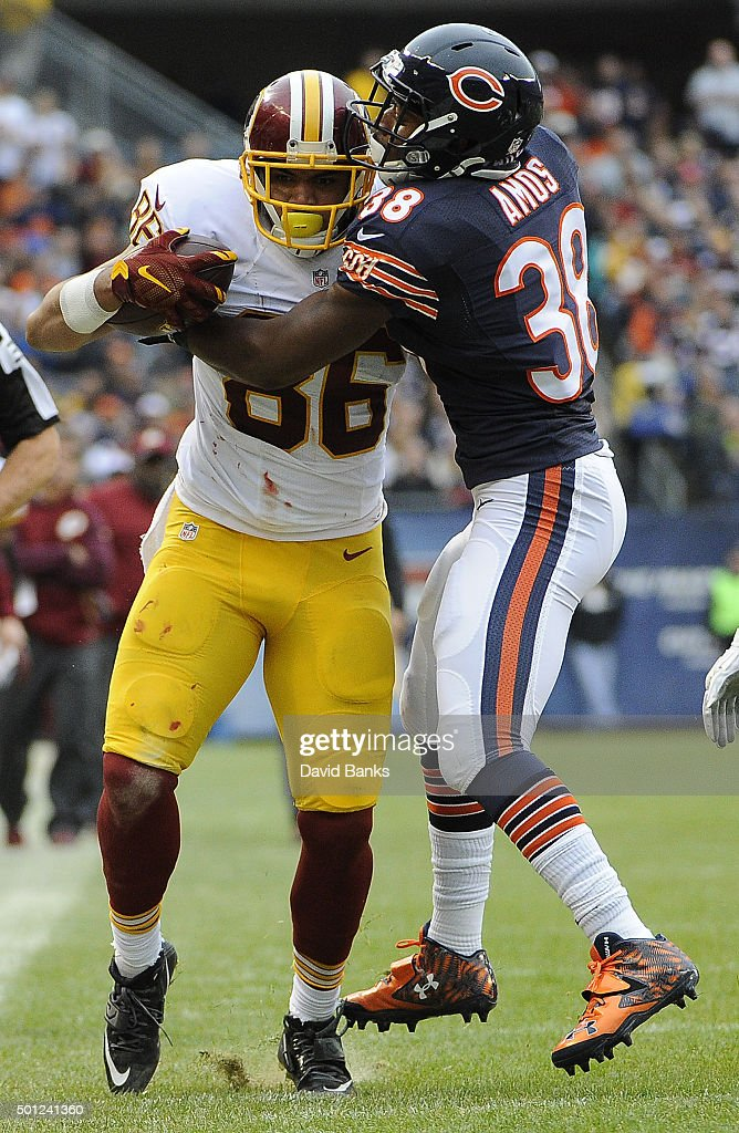 <a gi-track='captionPersonalityLinkClicked' href=/galleries/search?phrase=Jordan+Reed&family=editorial&specificpeople=6893664 ng-click='$event.stopPropagation()'>Jordan Reed</a> #86 of the Washington Redskins is tackled by <a gi-track='captionPersonalityLinkClicked' href=/galleries/search?phrase=Adrian+Amos&family=editorial&specificpeople=8489598 ng-click='$event.stopPropagation()'>Adrian Amos</a> #38 of the Chicago Bears during the first quarter on December 13, 2015 at Soldier Field in Chicago, Illinois.