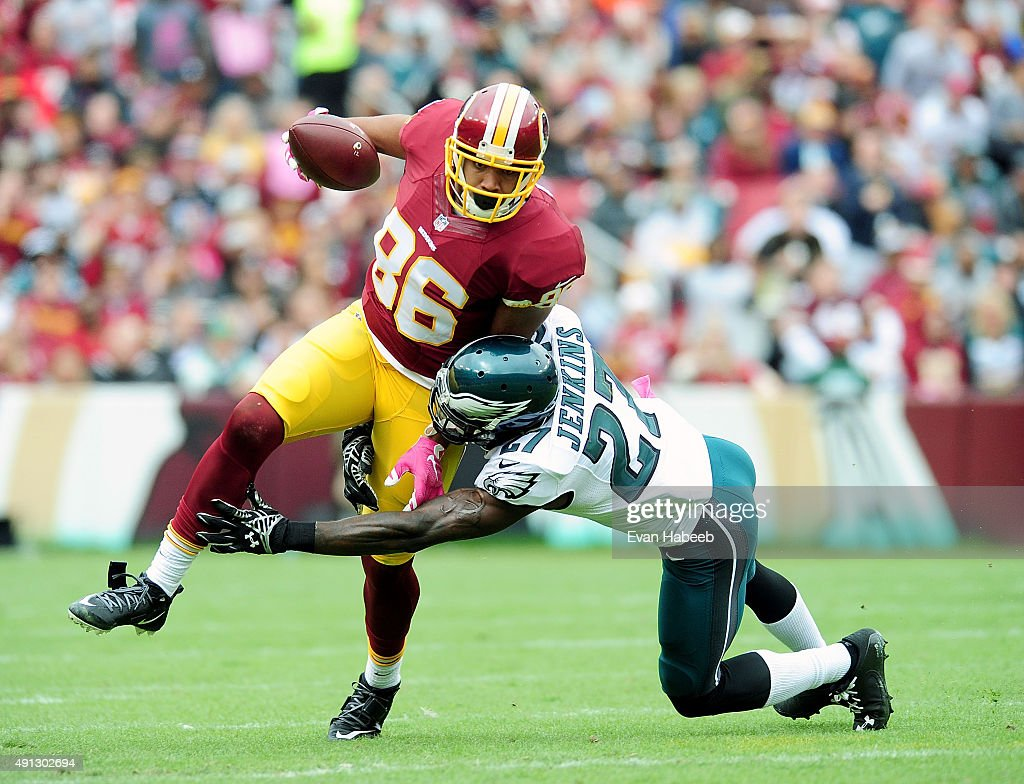 Jordan Reed of the Washington Redskins is tackled by Malcolm Jenkins of the Philadelphia Eagles at FedExField on October 4 2015 in Landover Maryland