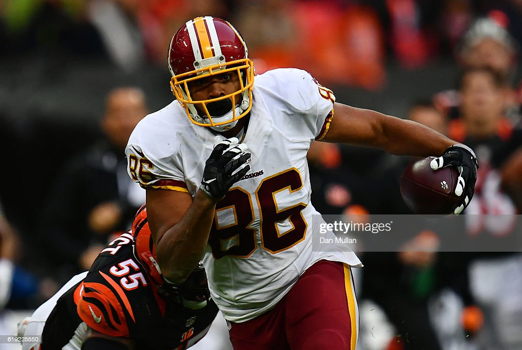 Jordan Reed #86 of the Washington Redskins makes a break past Vontaze Burfict #55 of the Cincinnati Bengals to score a touchdown during the NFL International Series Game between Washington Redskins and Cincinnati Bengals at Wembley Stadium on October 30, 2016 in London, England.