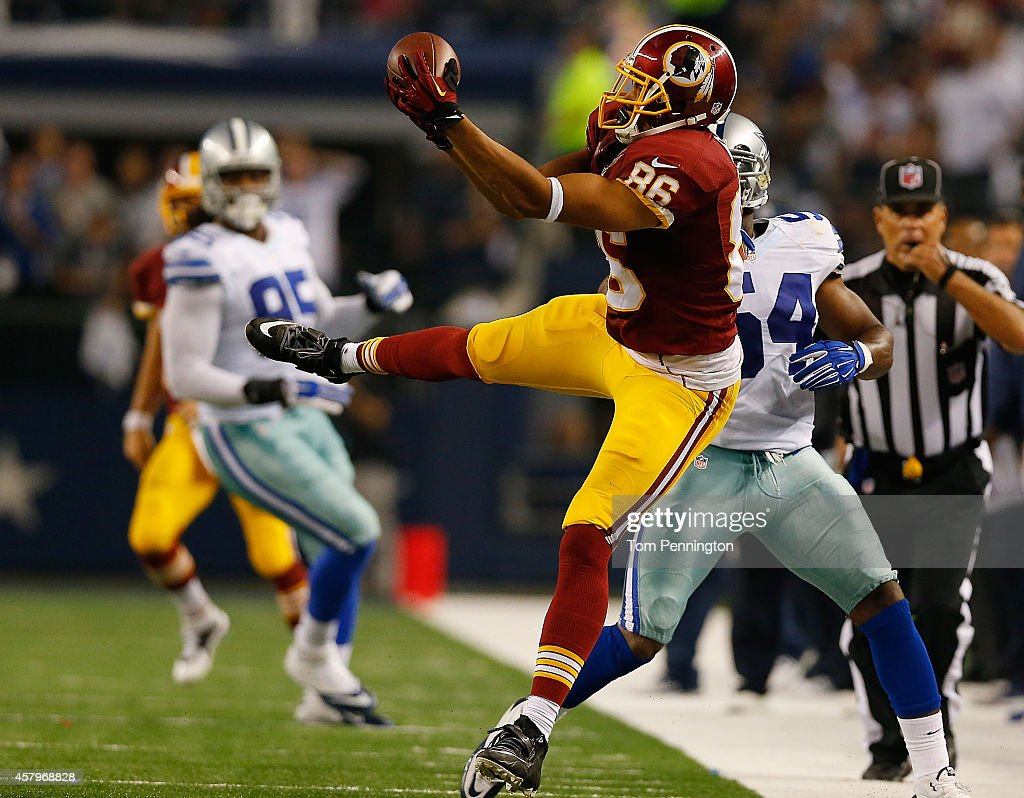 <a gi-track='captionPersonalityLinkClicked' href=/galleries/search?phrase=Jordan+Reed&family=editorial&specificpeople=6893664 ng-click='$event.stopPropagation()'>Jordan Reed</a> #86 of the Washington Redskins makes the catch over <a gi-track='captionPersonalityLinkClicked' href=/galleries/search?phrase=Bruce+Carter+-+Giocatore+di+football+americano&family=editorial&specificpeople=11332981 ng-click='$event.stopPropagation()'>Bruce Carter</a> #54 of the Dallas Cowboys during overtime at AT&T Stadium on October 27, 2014 in Arlington, Texas.