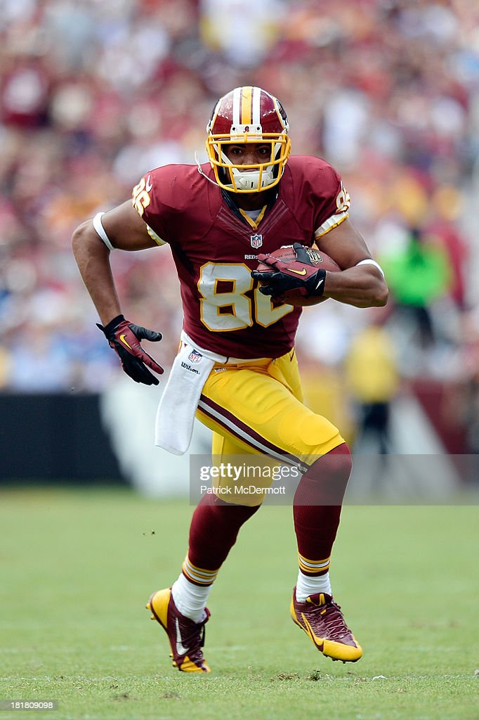 <a gi-track='captionPersonalityLinkClicked' href=/galleries/search?phrase=Jordan+Reed&family=editorial&specificpeople=6893664 ng-click='$event.stopPropagation()'>Jordan Reed</a> #86 of the Washington Redskins runs up field with the ball during a game against the Detroit Lions at FedExField on September 22, 2013 in Landover, Maryland.