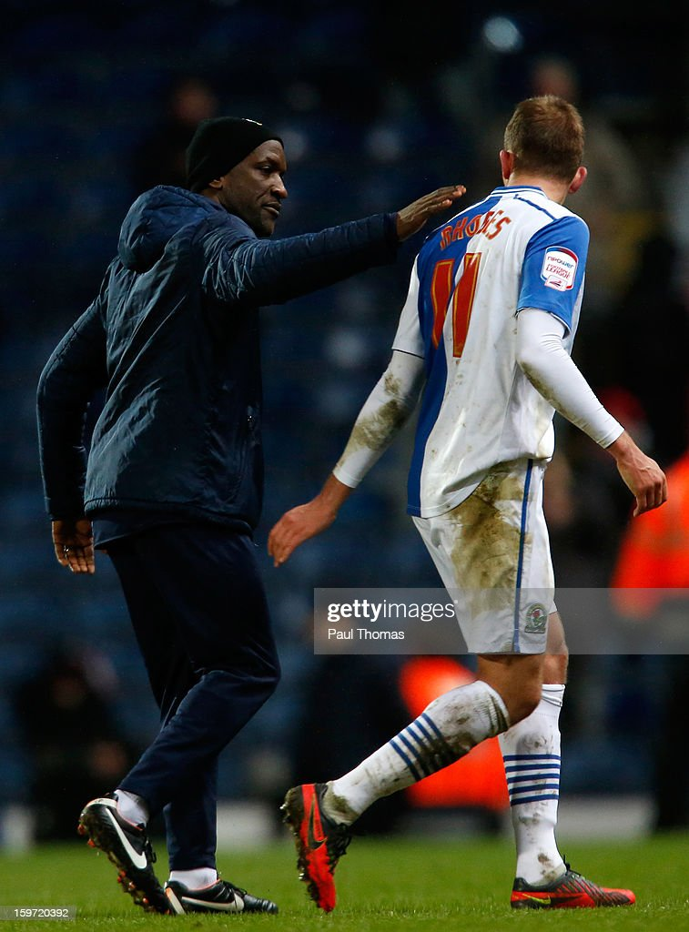 Jordan Rhodes (R) of Blackburn is consoled by Manager Chris Powell of Charlton after the npower Championship match between Blackburn Rovers and Charlton Athletic at Ewood Park on January 19, 2013 in Blackburn, England.