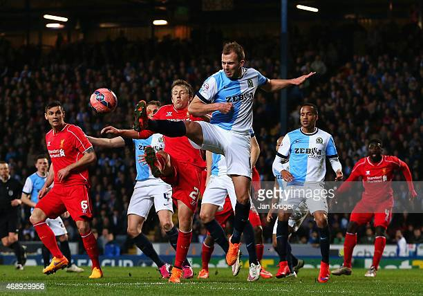 Jordan Rhodes of Blackburn Rovers challenges for the ball with Lucas Leiva of Liverpool during the FA Cup Quarter Final Replay match between...
