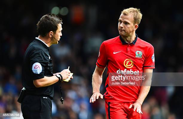 Jordan Rhodes of Blackburn speaks with referee Tony Harrington at Craven Cottage during the Sky Bet Football League Championship match between Fulham...