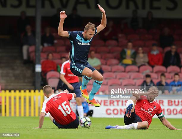 Jordan Rhodes of Middesbrough is tackled by Tyler Walton during the pre season friendly match between York City and Middlesbrough at Bootham Crescent...