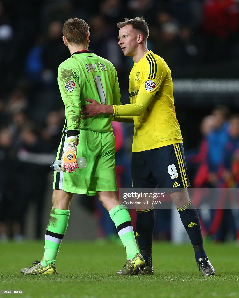 Jordan Rhodes of Middlesbrough consoles Goalkeeper David Martin of MK Dons after the Sky Bet Championship match between MK Dons and Middlesbrough at Stadium mk on February 9, 2016 in Milton Keynes, England.