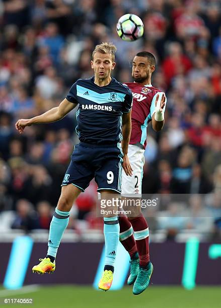 Jordan Rhodes of Middlesbrough wins a header over Winston Reid of West Ham United during the Premier League match between West Ham United and...
