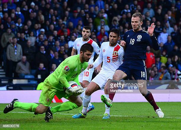 Jordan Rhodes of Scotland challenges goalkeeper Jamie Robba of Gibraltar during the EURO 2016 Group D qualifying match between Scotland and Gibraltar...