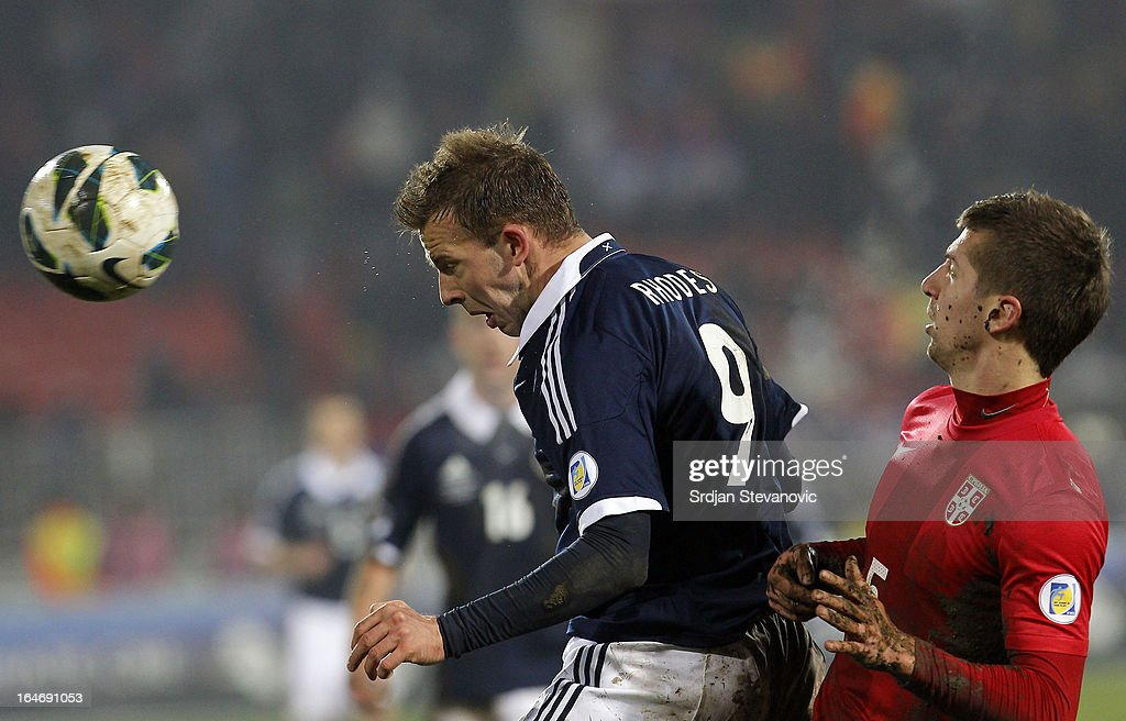 Jordan Rhodes (L) of Scotland in action against Matija Nastasic (R) of Serbia during the FIFA 2014 World Cup Qualifier between Serbia and Scotland at Karadjordje Stadium on March 26, 2013 in Novi Sad, Serbia.