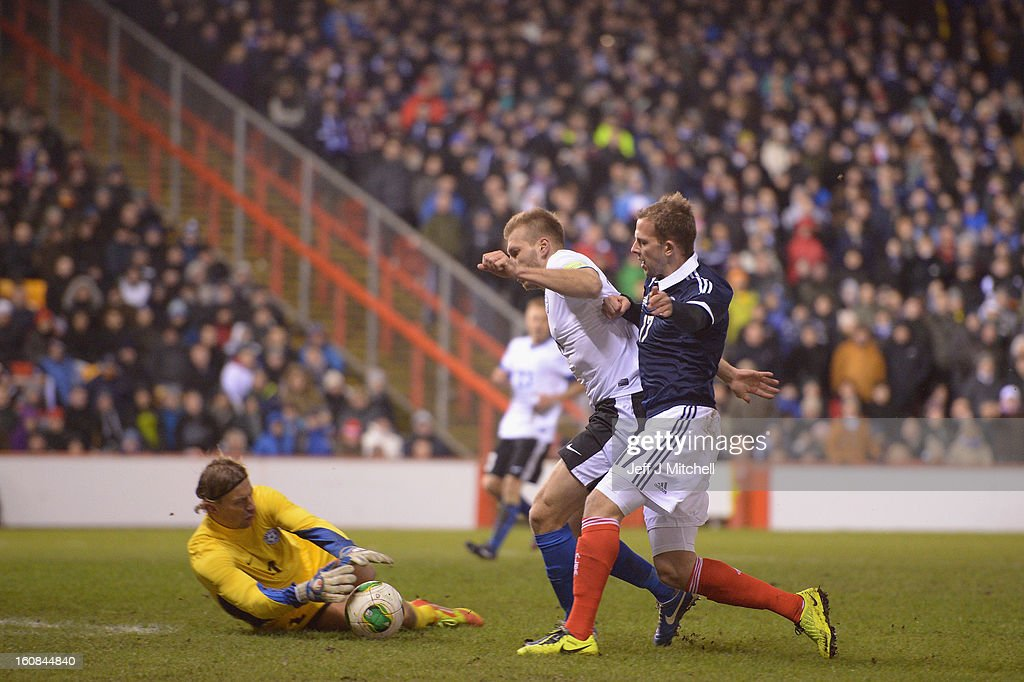 Jordan Rhodes of Scotland tackles Ragnar Klavan of Estonia during the international friendly match between Scotland and Estonia at Pittodrie Stadium on February 6, 2013 in Aberdeen, Scotland.