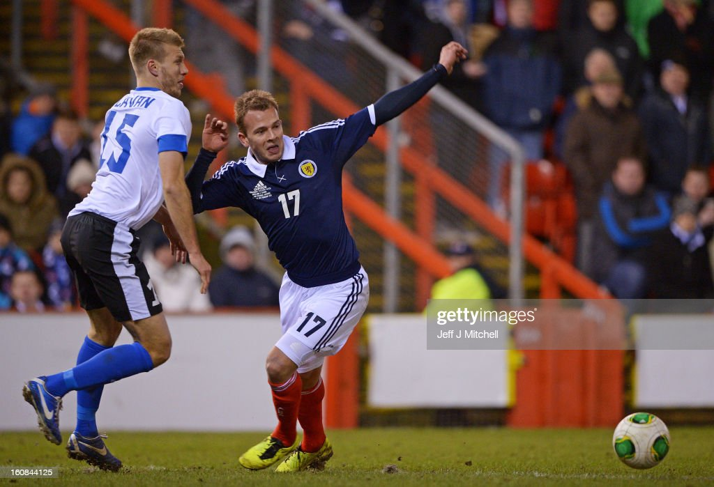 Jordan Rhodes of Scotland tacklesRagnar Klavan of Estonia during the international friendly match between Scotland and Estonia at Pittodrie Stadium on February 6, 2013 in Aberdeen, Scotland.