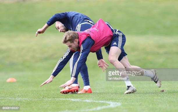 Jordan Rhodes vies with Stuart Armstrong during a training session at Mar Hall on March 23 2017 in Erskine Scotland