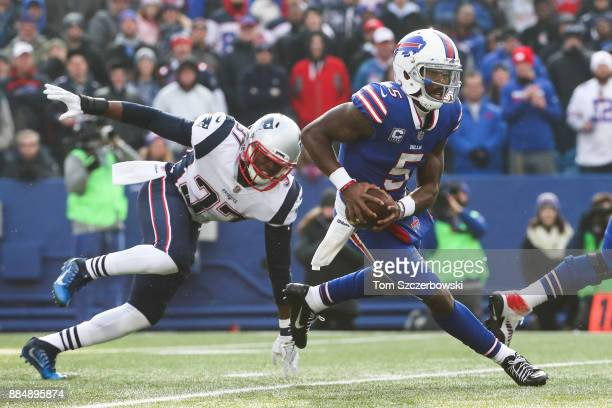 Jordan Richards of the New England Patriots attempts to tackle Tyrod Taylor of the Buffalo Bills during the first quarter on December 3 2017 at New...
