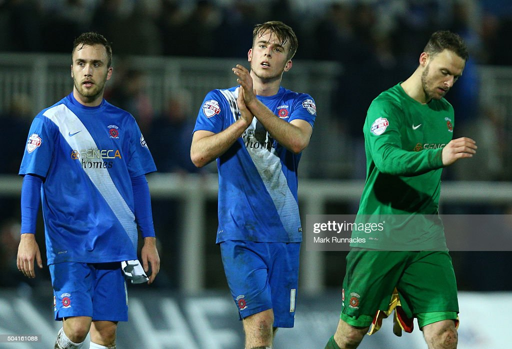 Jordan Richards, Rhys Oates and Trevor Carson of Hartlepool United walk from the pitch after their side lost to Derby County 2-1 during The Emirates FA Cup third round match between Hartlepool United FC and Derby County FC at Victoria Park on January 9, 2016 in Hartlepool, England.