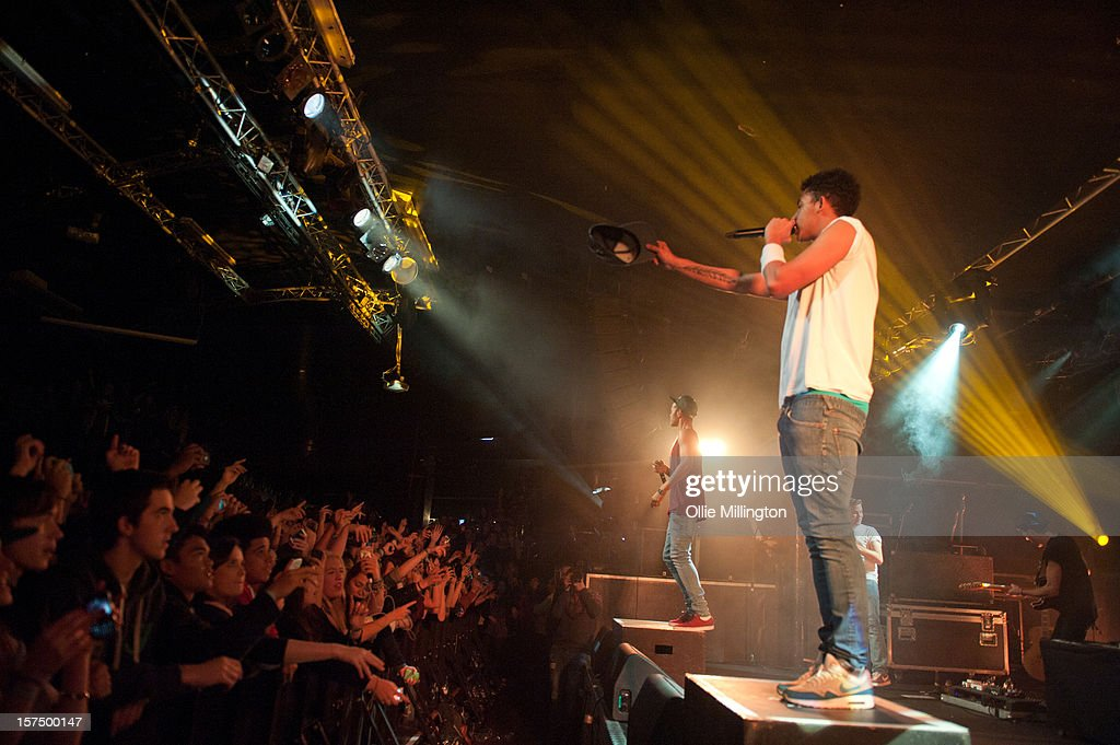 Jordan 'Rizzle' Stephens and Harley 'Sylvester' Alexander-Sule of Rizzle Kicks perform onstage during their December 2012 UK tour at Rock City on December 3, 2012 in Nottingham, England.