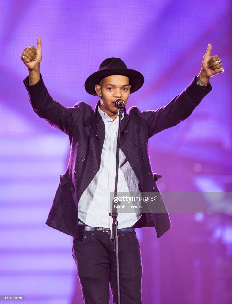 Jordan 'Rizzle' Stephens of Rizzle Kicks performs live on stage at the Unity concert in memory of Stephen Lawrence at O2 Arena on September 29, 2013 in London, England.