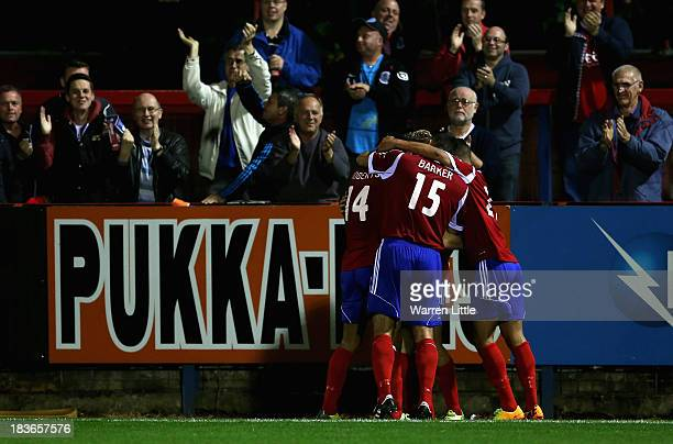 Jordan Roberts of Aldershot is congratulated by his team mates after scoring the second goal during the Skrill Conference Premier match between...