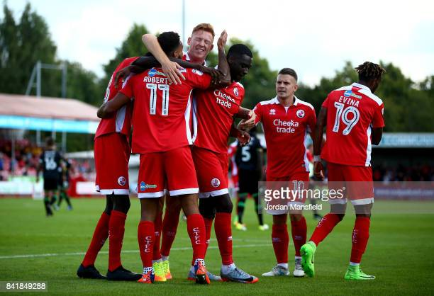 Jordan Roberts of Crawley Town celebrates with his teammates after scoring his sides first goal during the Sky Bet League Two match between Crawley...