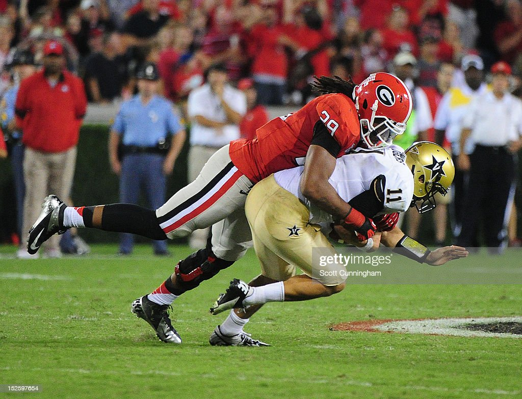 Jordan Rodgers #11 of the Vanderbilt Commodores is sacked on a 4th down play by <a gi-track='captionPersonalityLinkClicked' href=/galleries/search?phrase=Jarvis+Jones&family=editorial&specificpeople=6236463 ng-click='$event.stopPropagation()'>Jarvis Jones</a> #29 of the Georgia Bulldogs at Sanford Stadium on September 22, 2012 in Athens, Georgia.