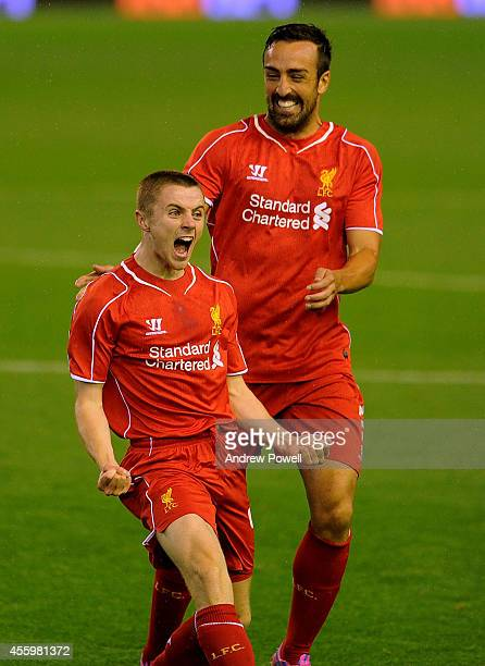 Jordan Rossiter celebrates his goal with Jose Enrique of Liverpool during the Capital One Cup Third Round match between Liverpool and Middlesbrough...