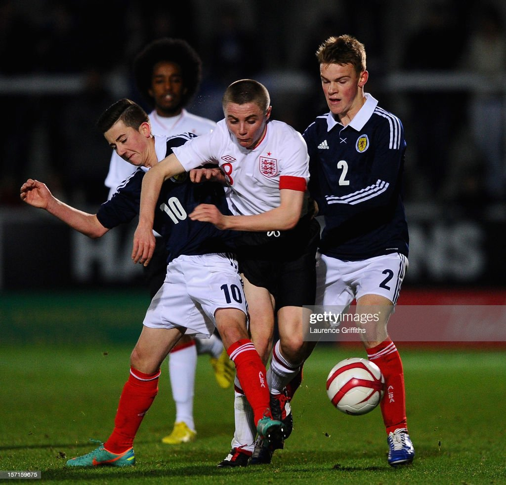 <a gi-track='captionPersonalityLinkClicked' href=/galleries/search?phrase=Jordan+Rossiter&family=editorial&specificpeople=8574887 ng-click='$event.stopPropagation()'>Jordan Rossiter</a> of England battles with Steven Boyd and Sam Wardrop of Scotland during the The Sky Sport Victory Shield match between England u16 and Scotland u16 at Pirelli Stadium on November 29, 2012 in Burton-upon-Trent, England.