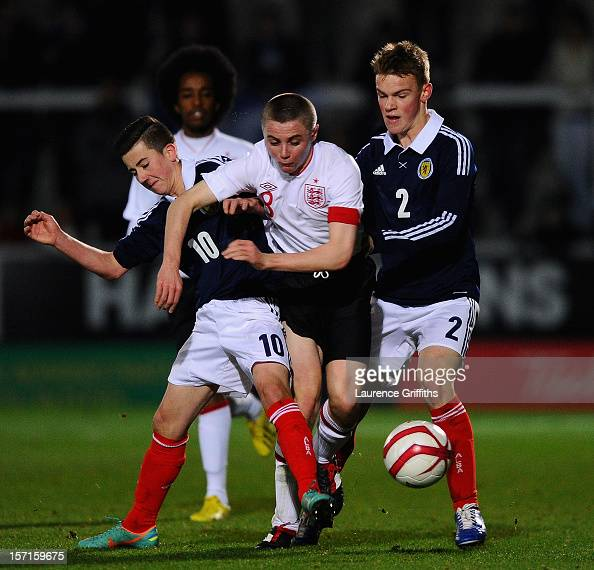 Jordan Rossiter of England battles with Steven Boyd and Sam Wardrop of Scotland during the The Sky Sport Victory Shield match between England u16 and...