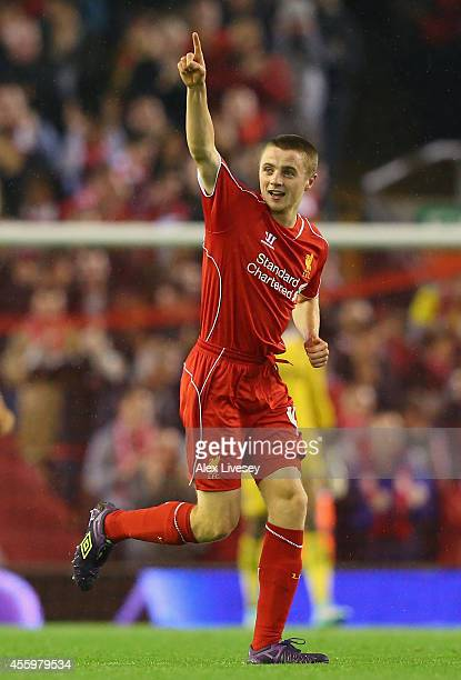 Jordan Rossiter of Liverpool celebrates after scoring the opening goal during the Capital One Cup Third Round match between Liverpool and...