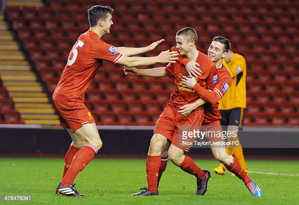 Jordan Rossiter of Liverpool celebrates his goal with Jordan Williams and Jack Dunn during the Barclays Premier League Under 21 fixture between...