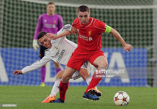 Jordan Rossiter of Liverpool competes with Gonzalo Merchan of Real Madrid CF during the UEFA Youth League match between Real Madrid CF and Liverpool...