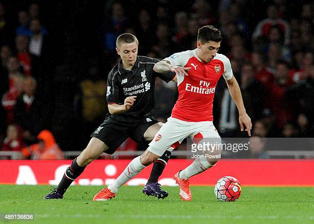 Jordan Rossiter of Liverpool competes with Hector Bellerin of Arsenal during the Barclays Premier League match between Arsenal and Liverpool on...