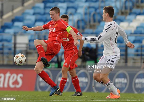 Jordan Rossiter of Liverpool competes with Jack Harper of Real Madrid CF during the UEFA Youth League match between Real Madrid CF and Liverpool FC...
