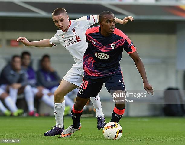 Jordan Rossiter of Liverpool competes with Nicolas MauriceBelay of FC Girondins de Bordeaux during the UEFA Europa League match between FC Girondins...