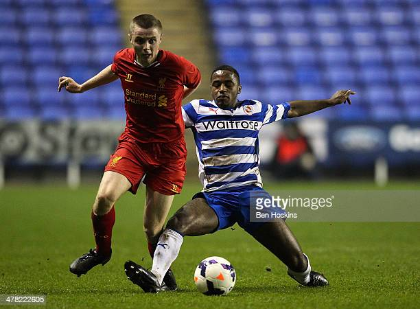 Jordan Rossiter of Liverpool is tackled by Tarique Fosu of Reading during the FA Youth Cup 6th Round match between Reading U18 and Liverpool U18 at...