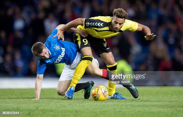 Jordan Rossiter of Rangers tackles Theo Sully of Progres Niederkorn during the UEFA Europa League first qualifying round match between Rangers and...
