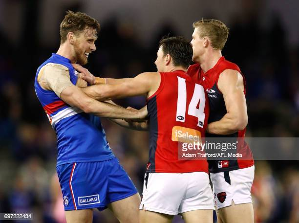 Jordan Roughead of the Bulldogs remonstrates with Michael Hibberd and Sam Frost of the Demons during the 2017 AFL round 13 match between the Western...