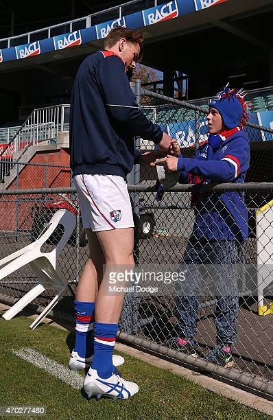 Jordan Roughead of the Bulldogs signs an autograph for a fan before the round three AFL match between the Hawthorn Hawks and the Western Bulldogs at...