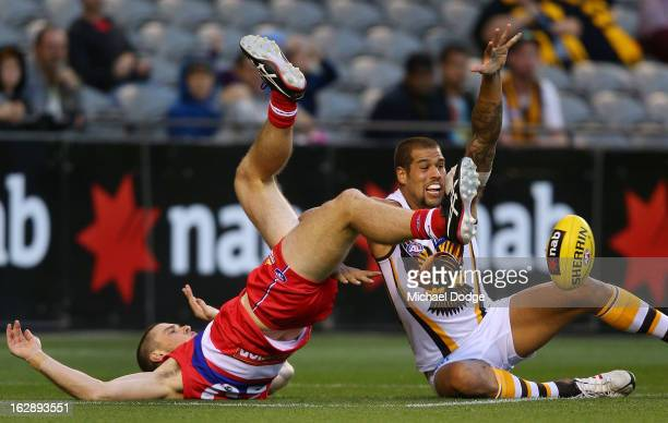 Jordan Roughead of the Western Bulldogs contests for the ball against Lance Franklin of the Hawthorn Hawks during round two NAB Cup AFL match between...