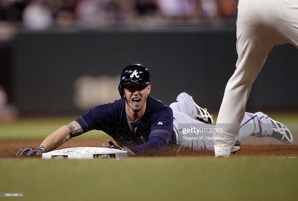 <a gi-track='captionPersonalityLinkClicked' href=/galleries/search?phrase=Jordan+Schafer&family=editorial&specificpeople=4958028 ng-click='$event.stopPropagation()'>Jordan Schafer</a> #17 of the Atlanta Braves dives into third base with a triple against the San Francisco Giants in the fifth inning at AT&T Park on May 9, 2013 in San Francisco, California.