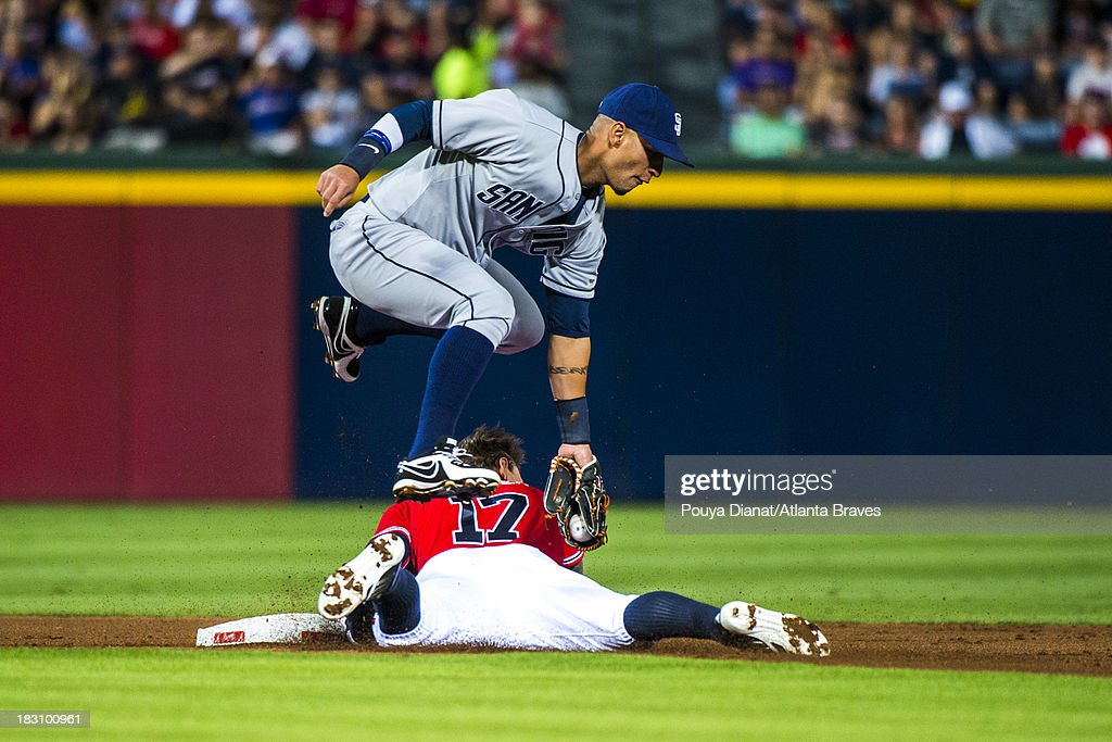 Jordan Schafer of the Atlanta Braves slides into second base as Ronny Cedeno of the San Diego Padres fields a ball at Turner Field on September 13...