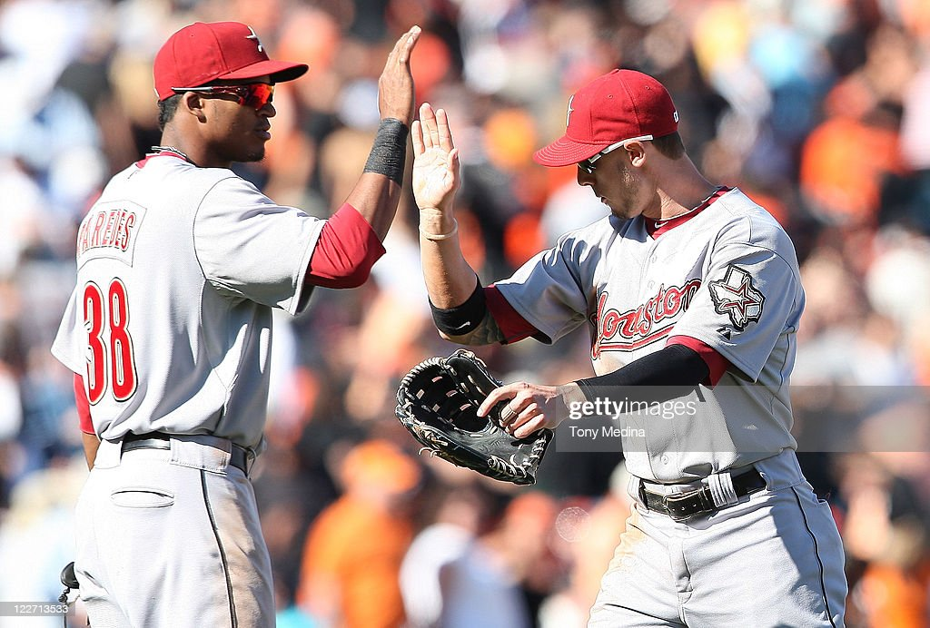 <a gi-track='captionPersonalityLinkClicked' href=/galleries/search?phrase=Jordan+Schafer&family=editorial&specificpeople=4958028 ng-click='$event.stopPropagation()'>Jordan Schafer</a> #1 of the Houston Astros and Jimmy Paredes #38 of the Houston Astros give each other high fives after the Houston Astros beat the San Francisco Giants 4-3 in eleven innings at AT&T Park on August 28, 2011 in San Francisco, California.