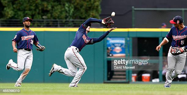 Jordan Schafer of the Minnesota Twins catches a ball hit by JB Shuck as Twins players Danny Santana abd Eduardo Escobar look on during the seventh...
