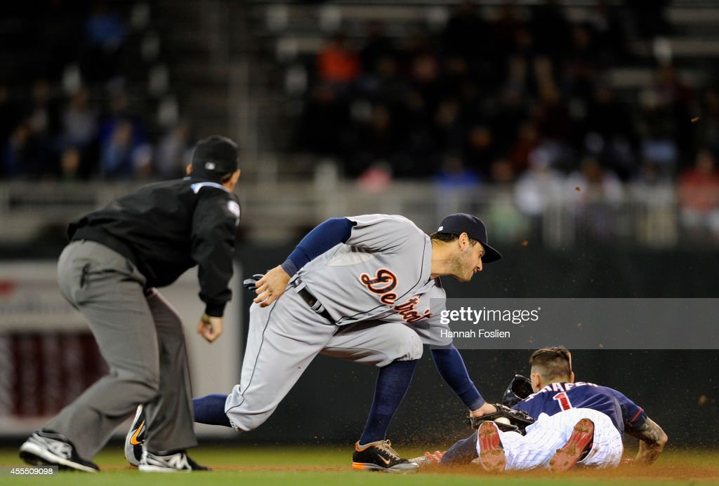 Jordan Schafer of the Minnesota Twins is caught stealing second base by Ian Kinsler of the Detroit Tigers during the seventh inning of the game on...