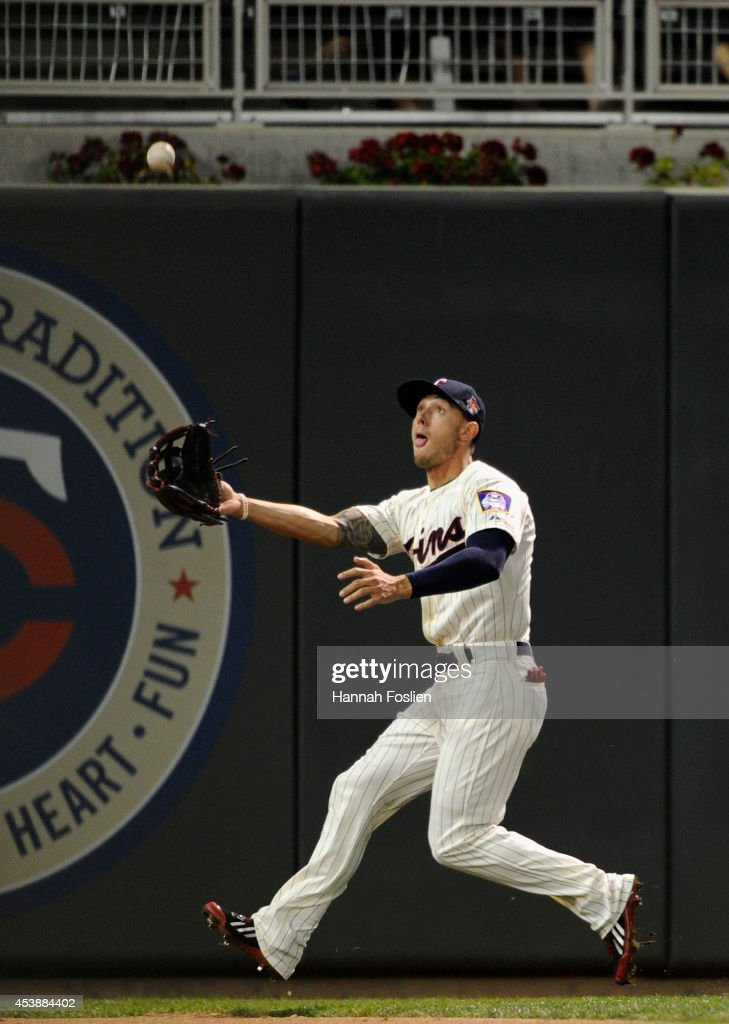<a gi-track='captionPersonalityLinkClicked' href=/galleries/search?phrase=Jordan+Schafer&family=editorial&specificpeople=4958028 ng-click='$event.stopPropagation()'>Jordan Schafer</a> #1 of the Minnesota Twins makes a catch in left field on a ball off the bat of Zach Walters of the Cleveland Indians during the eighth inning of the game on August 20, 2014 at Target Field in Minneapolis, Minnesota. The Indians defeated the Twins 5-0.